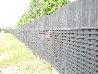 Sherrie Wilcox standing by FEMA coffins outside of Atlanta