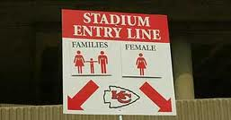 This is one of the signs outside of Arrowhead Stadium, home of the Kansas City NFL team. Notice the segregation of single females. Can you think of a legitimate reason why stadium authorities would segregate fans.....? It is all part of the conditioning process.