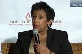 This is the face of a domestic terrorist. She will jail all talk show hosts who speak out against Muslim extremism. One day following the San Bernardino massacre, she did not utter a word about the 14 Americans that were executed by a Muslim terrorist. But Lynch(mob) threatens to arrest anyone speaking out against Muslim extremism. I do not have words to describe how out of touch this administration is with the American people. Please not the background as Lynch delivered her threat to Americans who will not submit to extremism and Sharia Law.